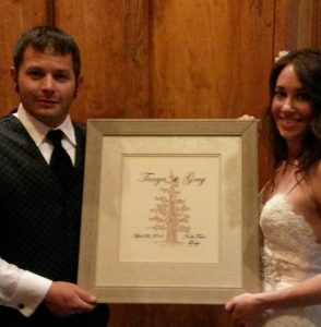 Bride & Groom Holding Wedding Invitation