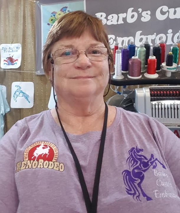 Employee with Custom Embroided T-Shirt On