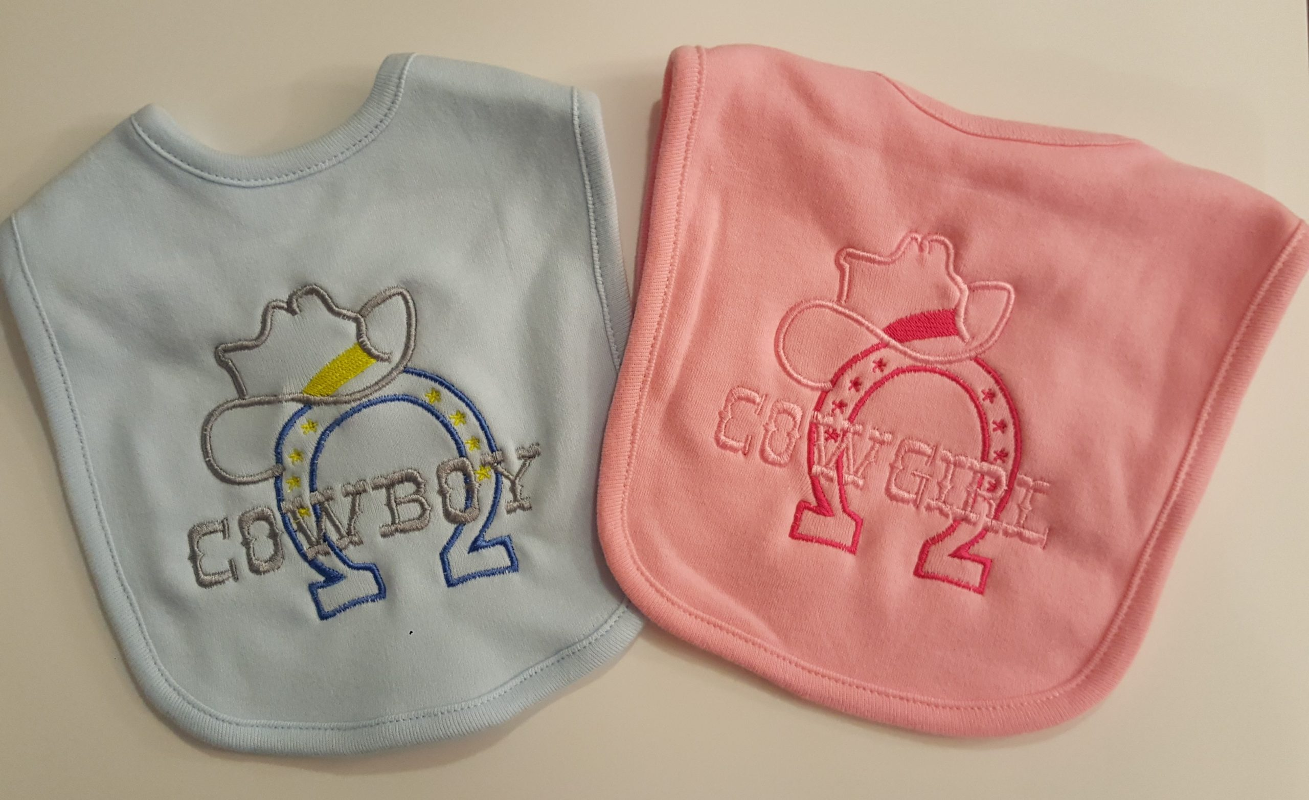 Custom Embroidered Bibs in pink and blue