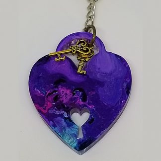 A blue alcohol ink heart keychain.
