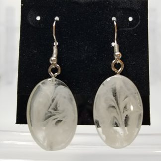 A pair of white glass oval earrings.